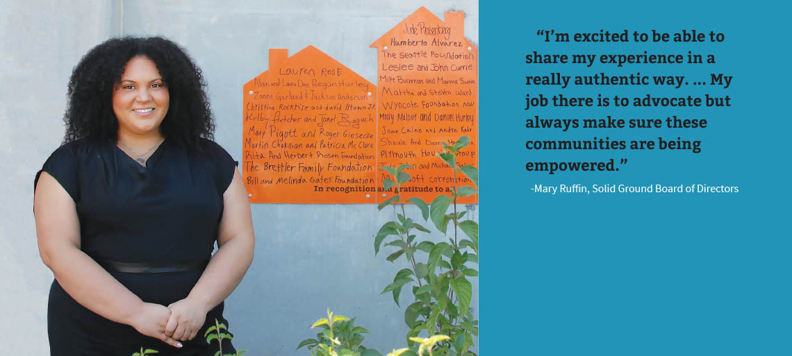 """Black woman with curly hair wearing all black in front of orange housing-shaped signage on a concrete wall. Right side, black text on a blue background: """"I'm excited to be able to share my experience in a really authentic way. ... My job there is to advocate but always make sure these communities are being empowered."""" -Mary Ruffin, Solid Ground Board of Directors"""
