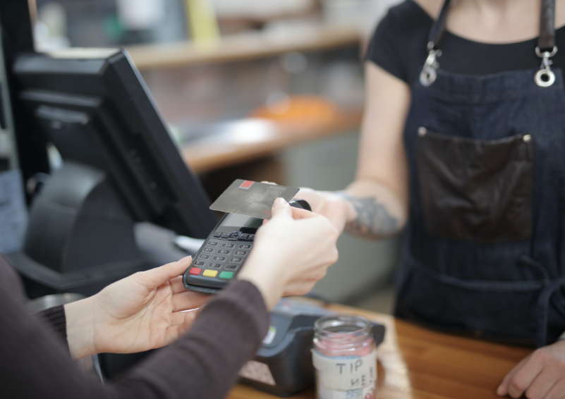 A customer scanning their credit card to make a purchase
