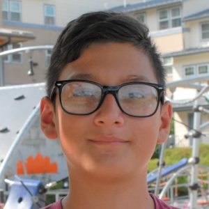A young smiling boy with glasses