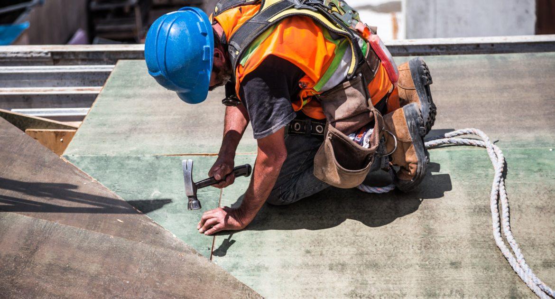 A construction worker using a hammer